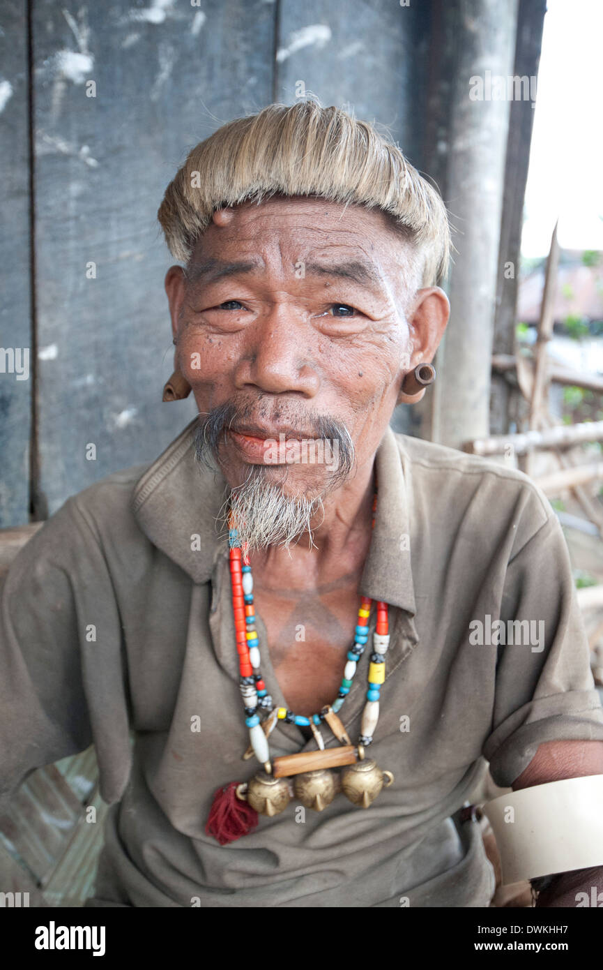 Naga Konyak tribal head hunter with traditional headhunter necklace, Ngangting, Nagaland, India - Stock Image