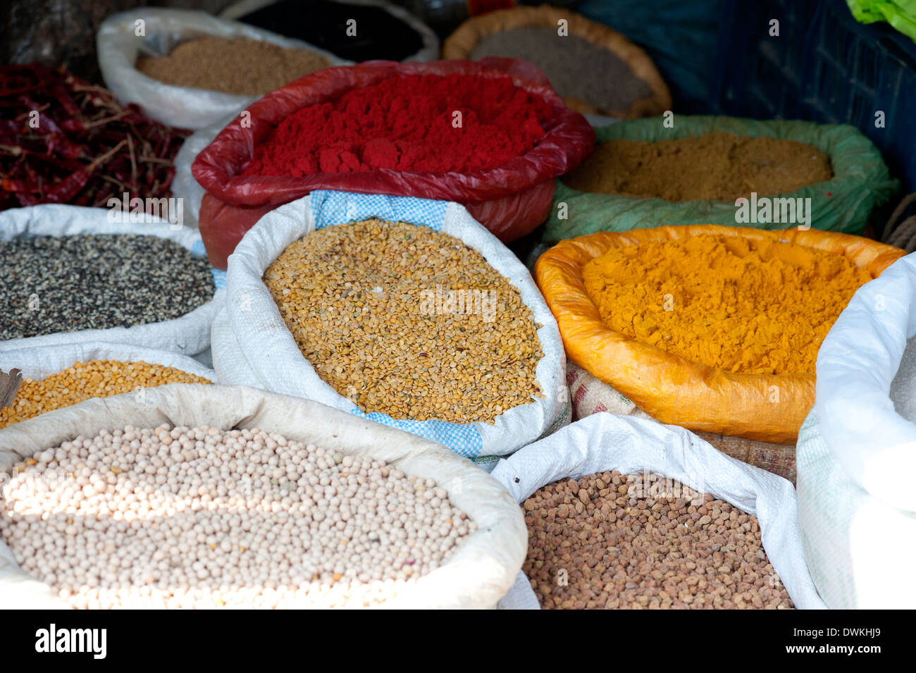 Pulses and spices in sacks for sale in Tizit village weekly local market, Nagaland, India, Asia - Stock Image