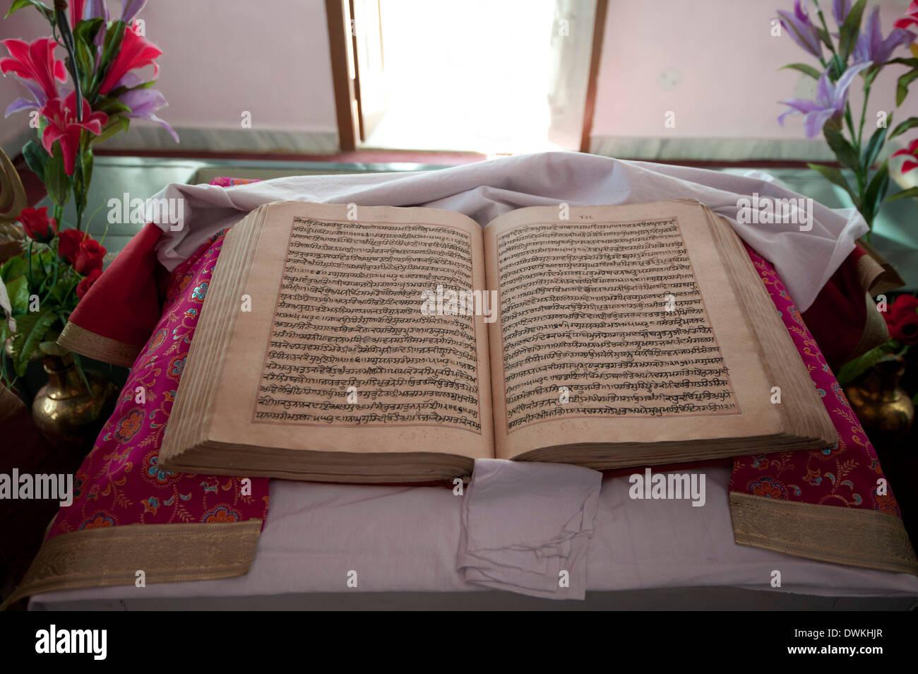 The Guru Granth Sahib, the Sikh holy book, Gurudwara Sri Guru Tegh Bahadur Sahib Sikh temple, Dhubri, Assam, India - Stock Image