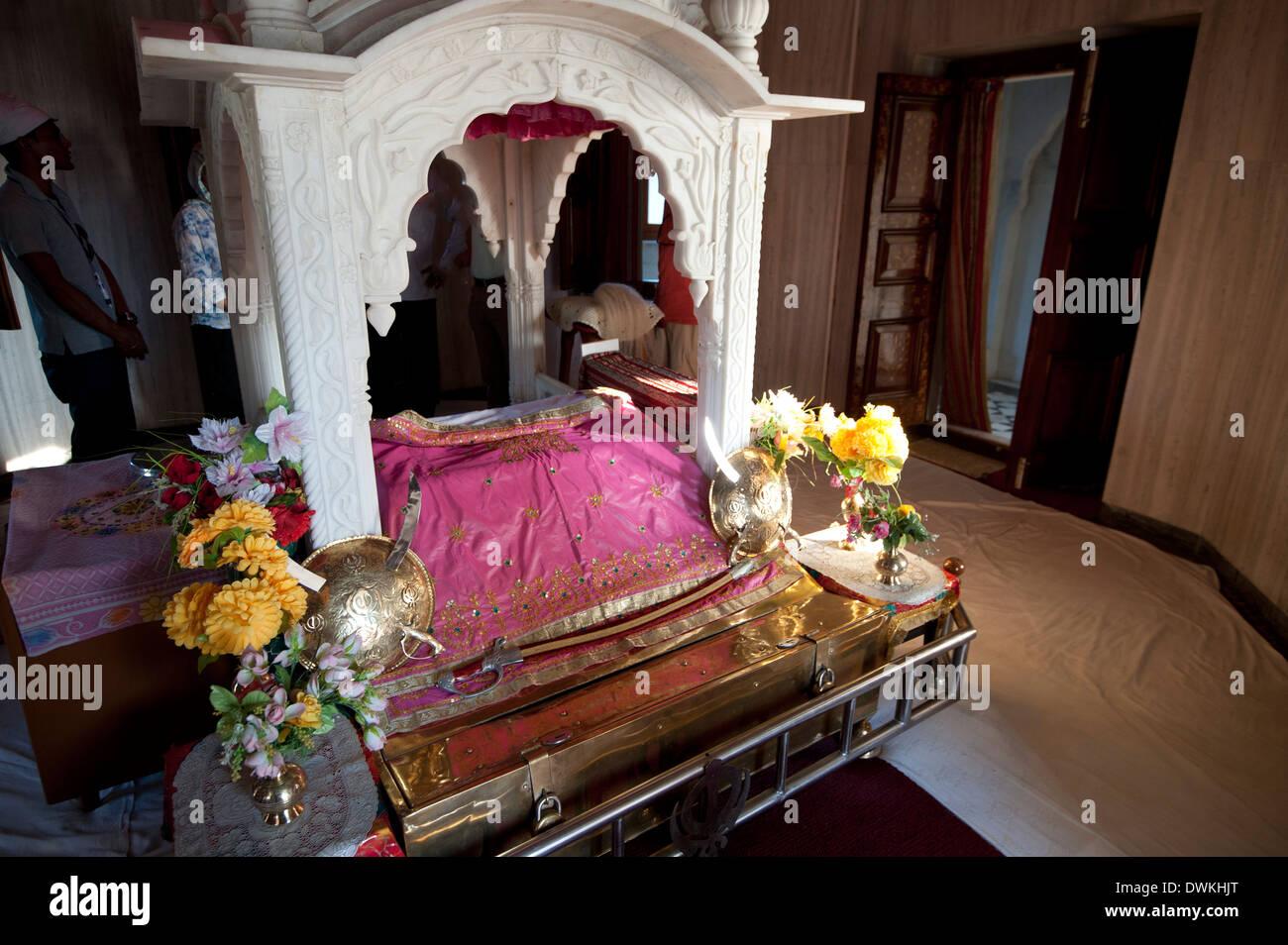 Guru Granth Sahib, the Sikh holy book at the Gurudwara Sri Guru Tegh Bahadur Sahib Sikh temple, Dhubri, Assam, India - Stock Image