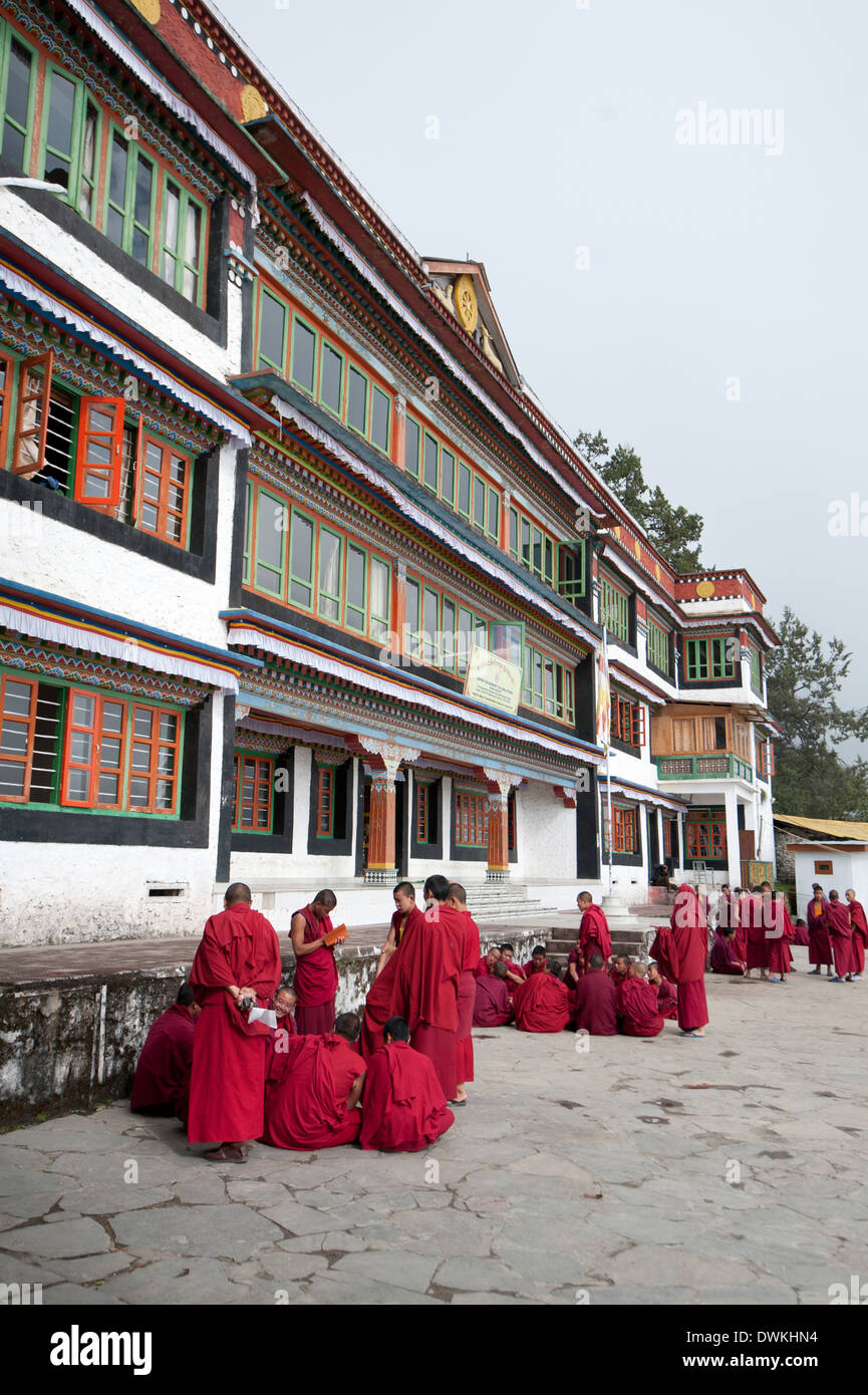 Buddhist monks gathering in groups in front of Tawang Buddhist monastery, the largest in India, Arunachal Pradesh, India - Stock Image