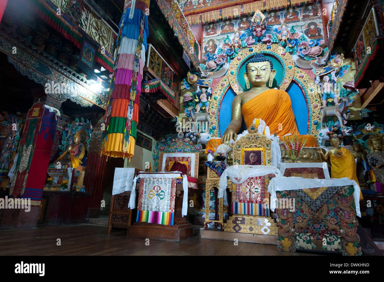 Large Buddha shrine in prayer hall, with photograph of the Dalai Llama, Tawang monastery, Arunachal Pradesh, India, Asia - Stock Image