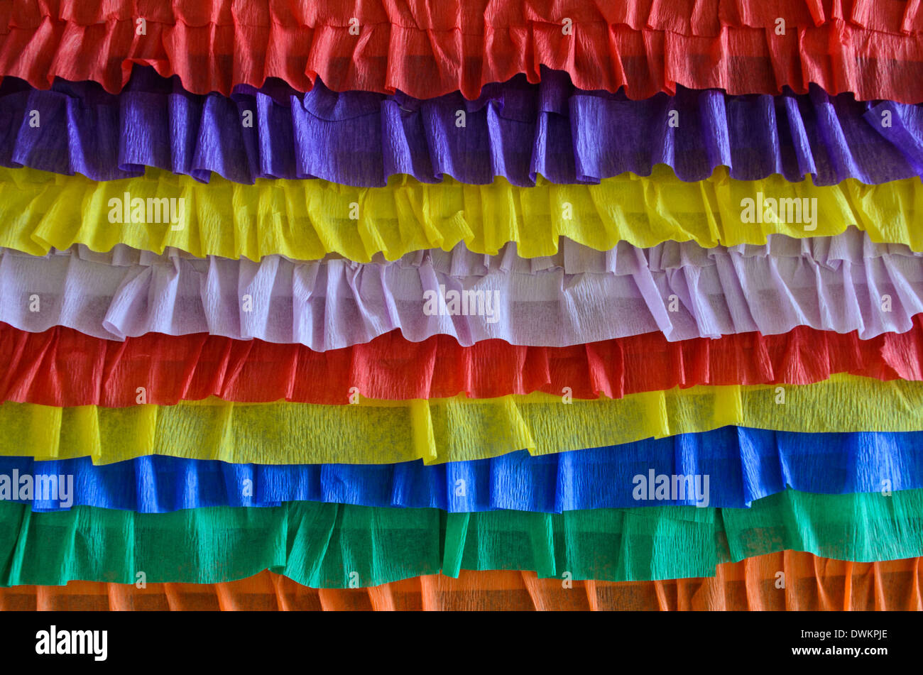 Rainbow crepe streamers decoration for Saint Patrick's day - Stock Image