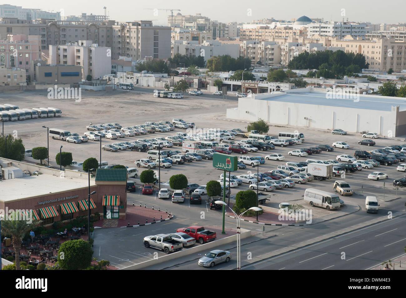 Parking lot and buildings, C Ring Road, Fereej Bin Mahmoud Doha Qatar - Stock Image