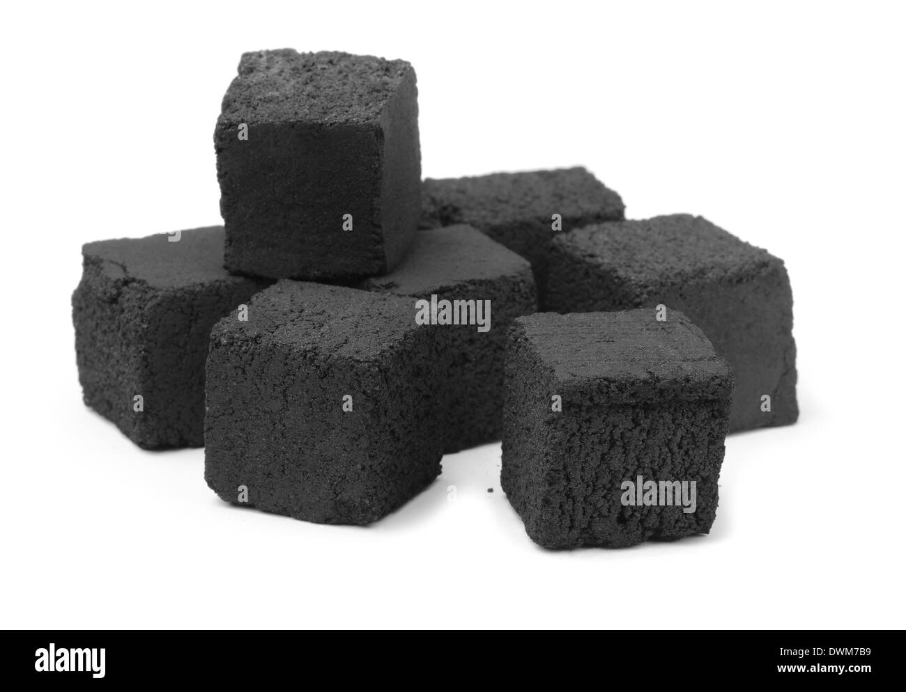 Group of charcoal cubes isolated on white - Stock Image