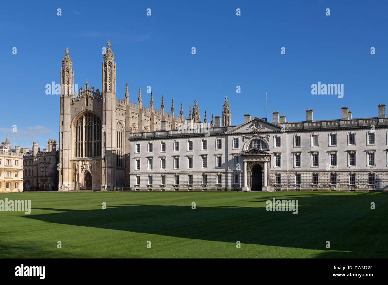 Kings College Cambridge back lawn Chapel and Gibbs building on a sunny day - Stock Image