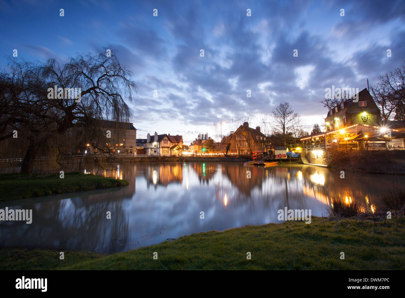 Night time reflections in the Mill Pond river Cam Cambridge, UK - Stock Image