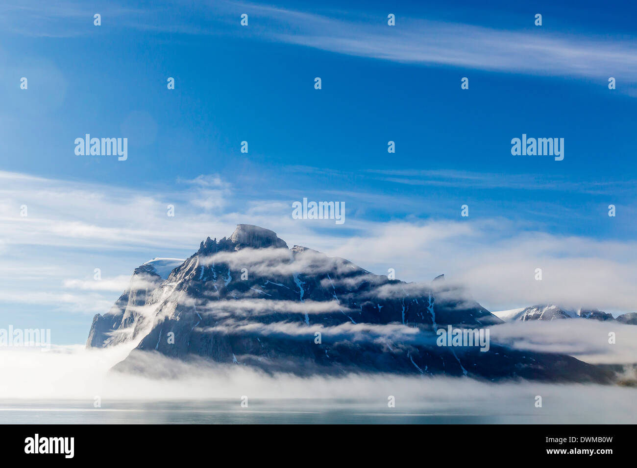 Fog lifting on the steep cliffs of Icy Arm, Baffin Island, Nunavut, Canada, North America Stock Photo