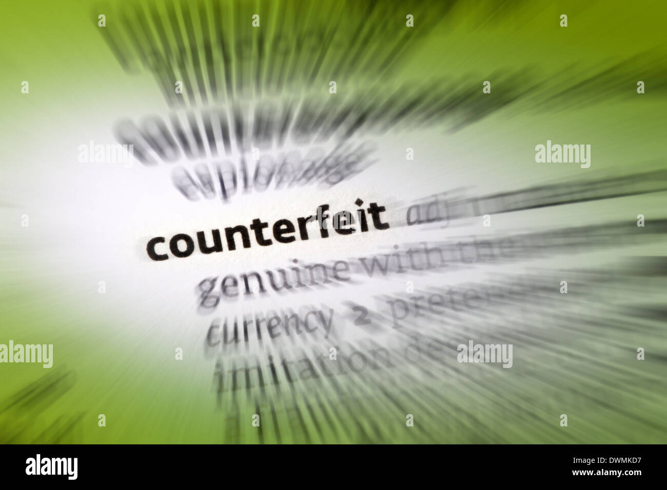 Counterfeit - an object made in exact imitation of something valuable or important with the intention to deceive or defraud - Stock Image