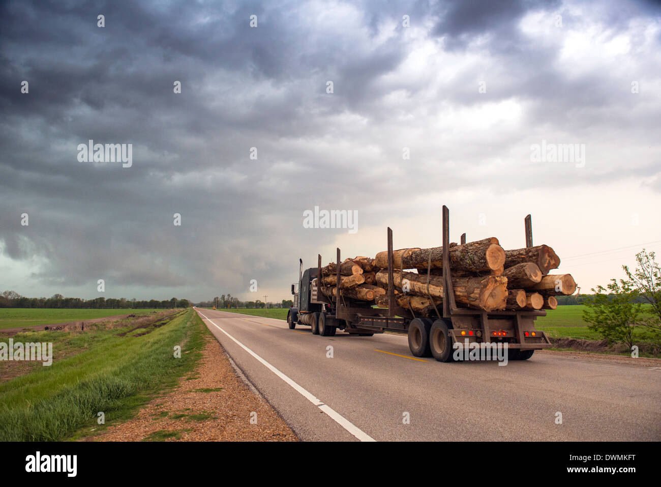 Logging truck in Mississippi driving into the heart of a thunderstorm with an extreme tornado watch, United States of America - Stock Image