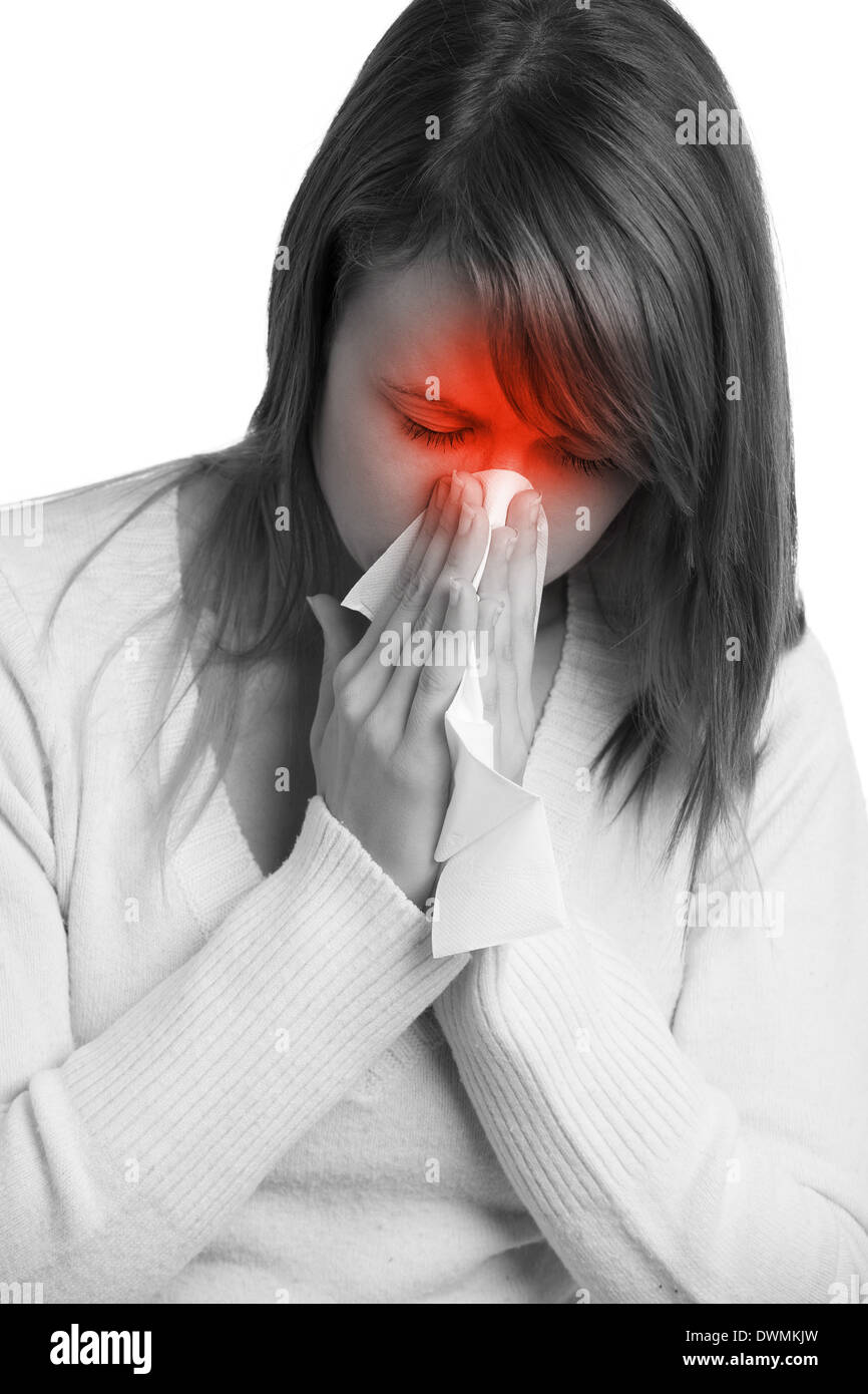 Woman with flu sneezing - Stock Image