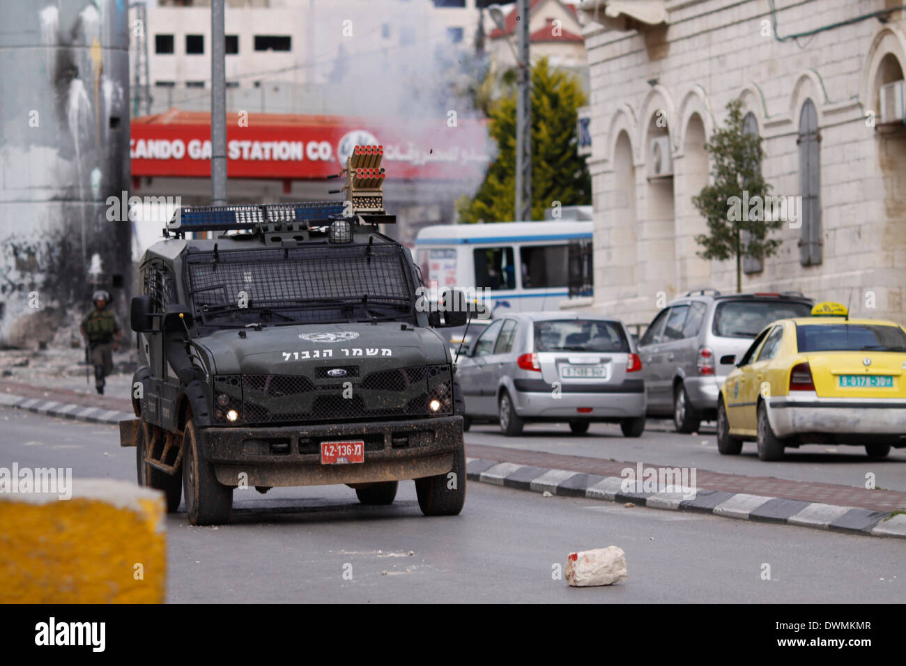 Israeli border police jeep broke into the streets of Bethlehem shooting tear gas at Palestinians, during clashes. - Stock Image