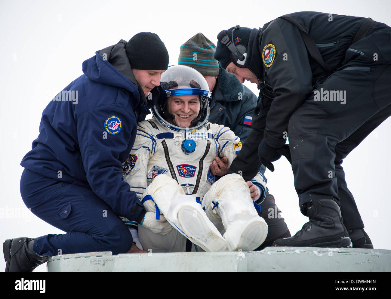 International Space State Expedition 38 cosmonaut Sergey Ryazanskiy of the Russian Federal Space Agency, is lifted out of the Soyuz Capsule after landing in a Soyuz TMA-10M spacecraft March 11, 2014 near the town of Zhezkazgan, Kazakhstan. Hopkins, Kotov and Ryazanskiy returned to Earth after five and a half months onboard the International Space Station where they served as members of the Expedition 37 and 38 crews. - Stock Image