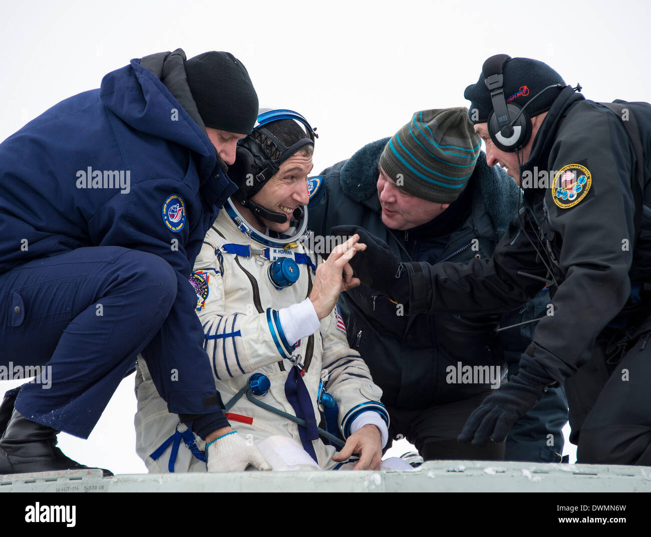 International Space State Expedition 38 astronaut Mike Hopkins of NASA is lifted out of the Soyuz Capsule after landing in a Soyuz TMA-10M spacecraft March 11, 2014 near the town of Zhezkazgan, Kazakhstan. Hopkins, Kotov and Ryazanskiy returned to Earth after five and a half months onboard the International Space Station where they served as members of the Expedition 37 and 38 crews. - Stock Image