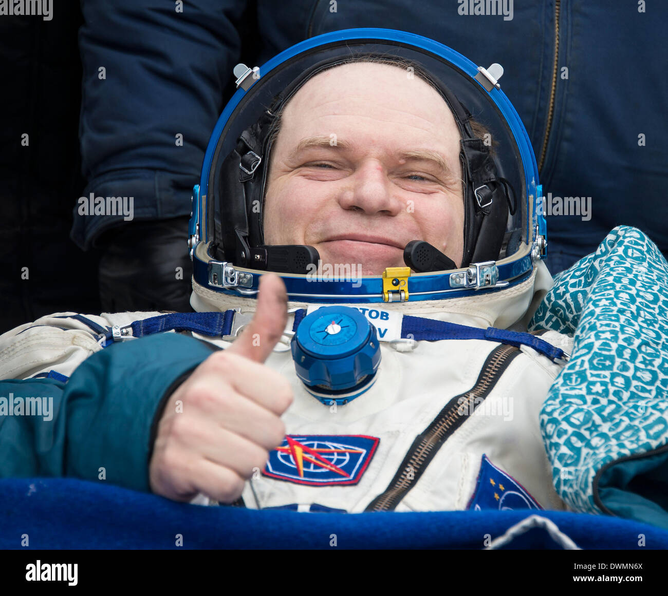 International Space State Expedition 38 Commander Oleg Kotov of the Russian Federal Space Agency gives a thumbs up outside of the Soyuz Capsule after landing in a Soyuz TMA-10M spacecraft March 11, 2014 near the town of Zhezkazgan, Kazakhstan. Hopkins, Kotov and Ryazanskiy returned to Earth after five and a half months onboard the International Space Station where they served as members of the Expedition 37 and 38 crews. - Stock Image