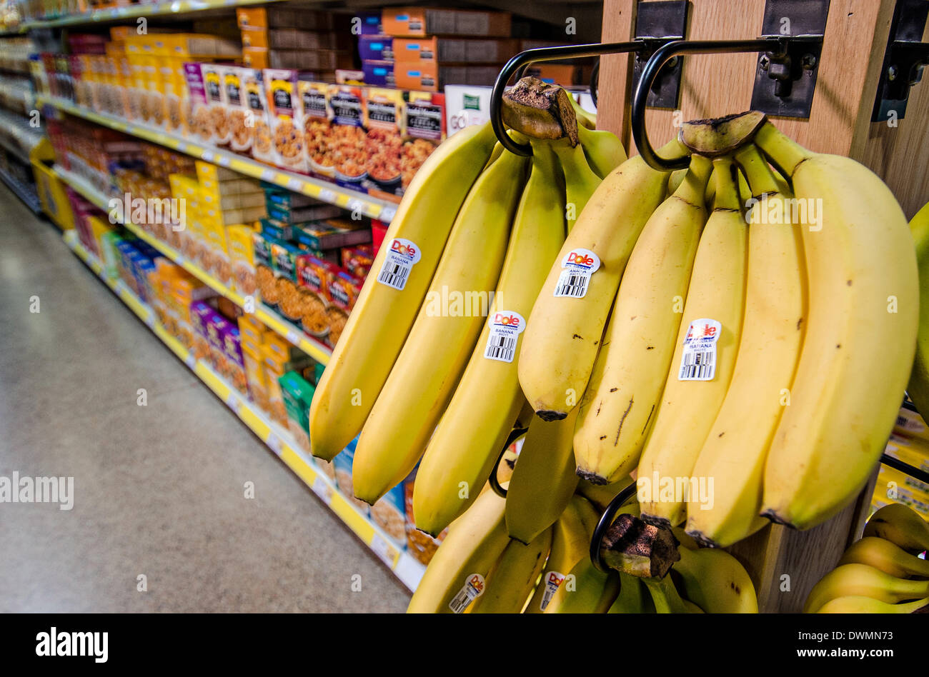 Dole brand bananas on display at a grocery store March 10, 2014 in Fairfax, Virginia. Chiquita Brands International and Ireland's Fyffes have agreed to merge March 11, 2014 displacing Dole as the world's biggest banana company in a deal valued at $1.07 billion - Stock Image