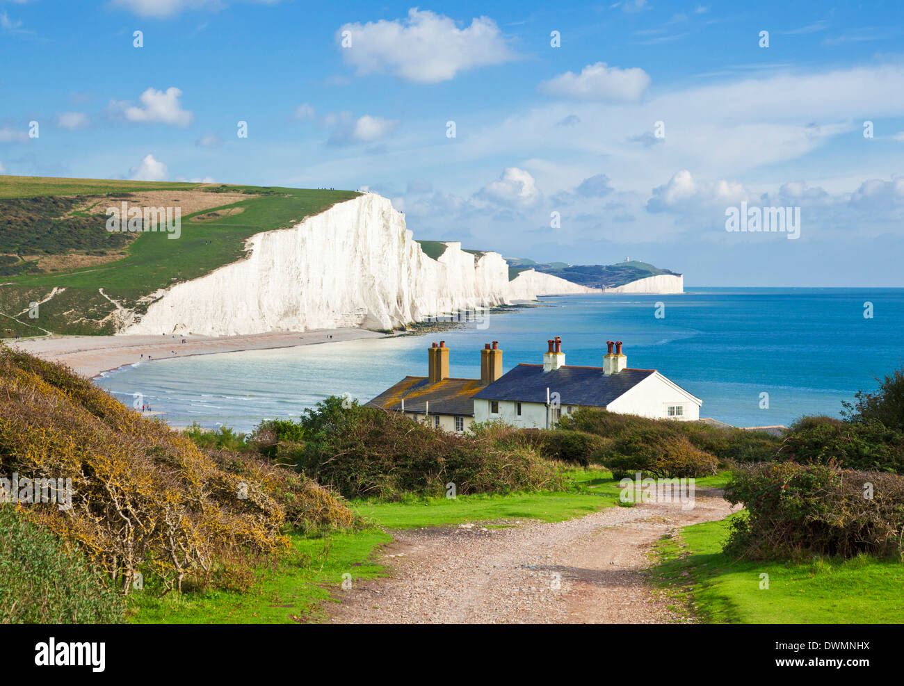 The Seven Sisters chalk cliffs and coastguard cottages, South Downs Way, South Downs National Park, East Sussex, England, UK - Stock Image