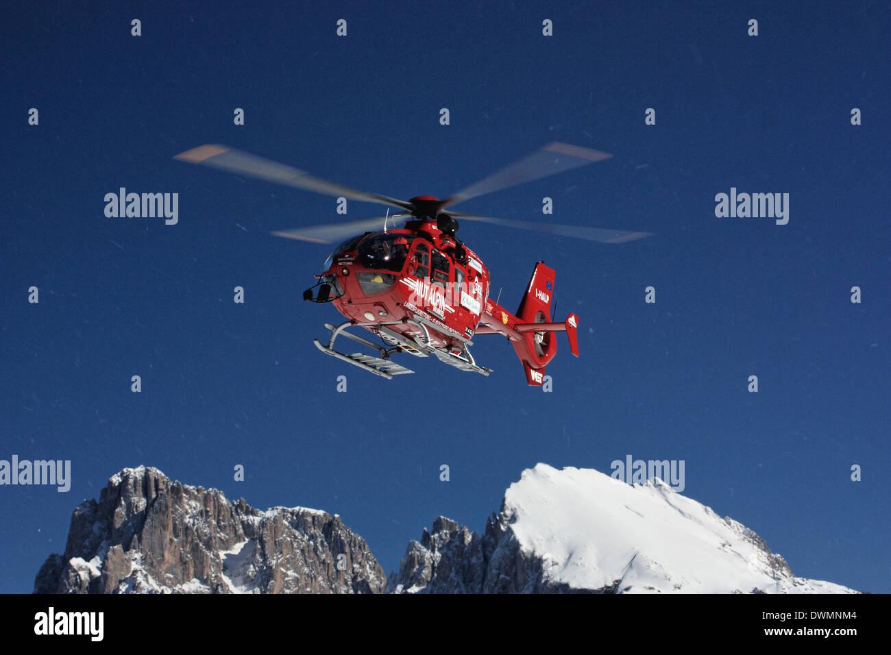 'Aiut Alpin Dolomites' heli mountain rescue, EUROCOPTER EC 135 T2, Seiser Alm / Alpe di Siusi, South Tyrol, Italy - Stock Image
