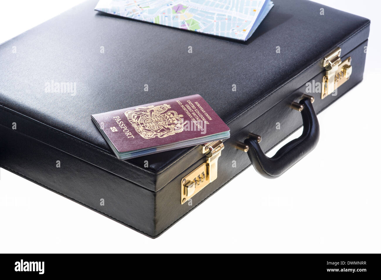 Business persons briefcase with UK passport and street map. - Stock Image