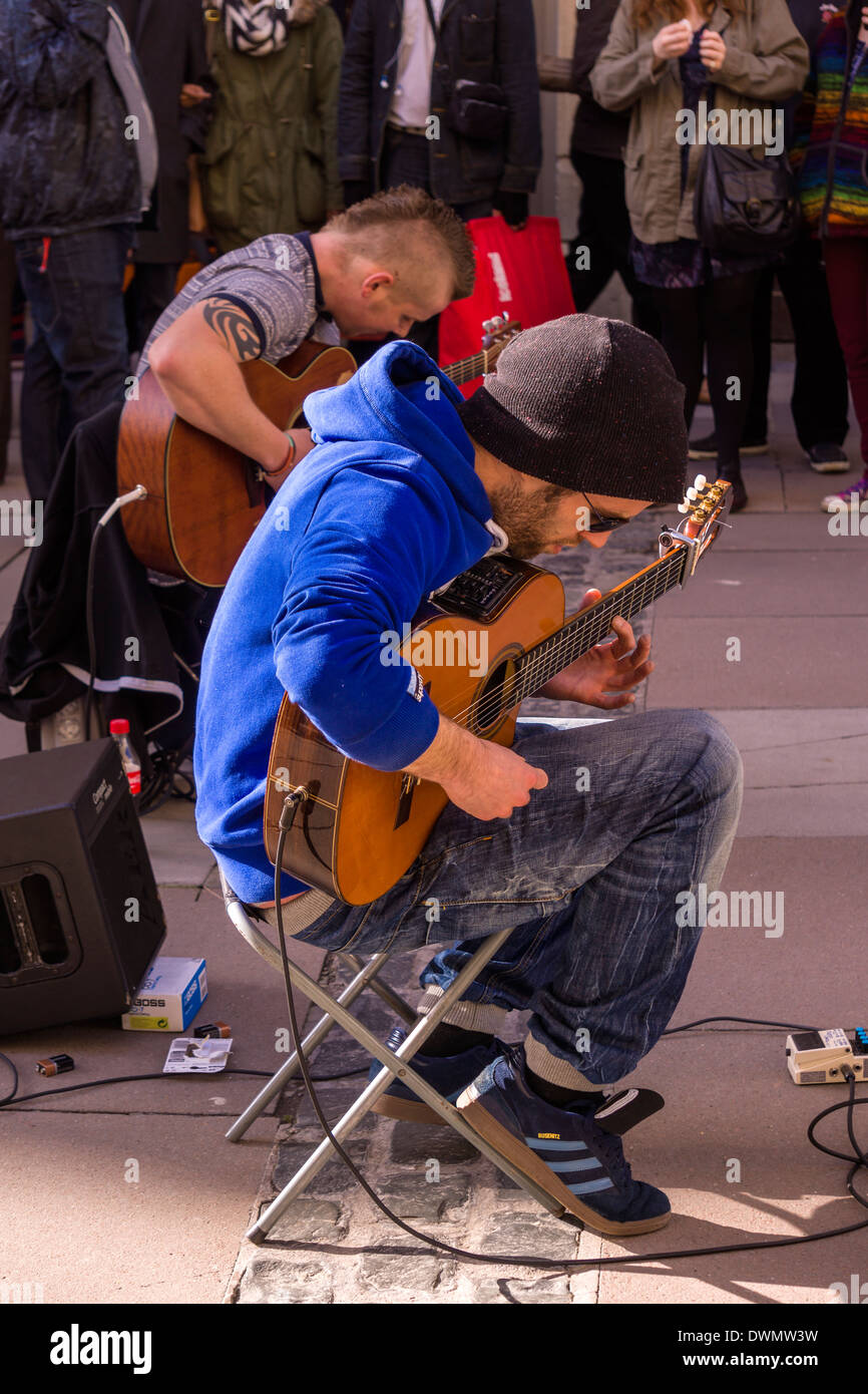 Two Guitarists entertain the crowds on the streets of Bath, Somerset - England. - Stock Image
