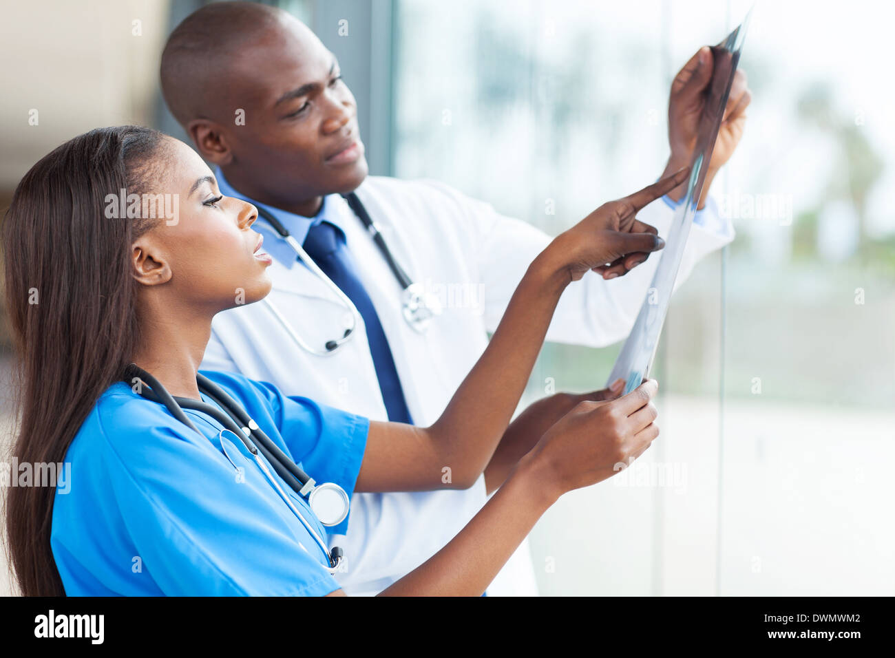African doctors looking at patient's x-ray at hospital - Stock Image
