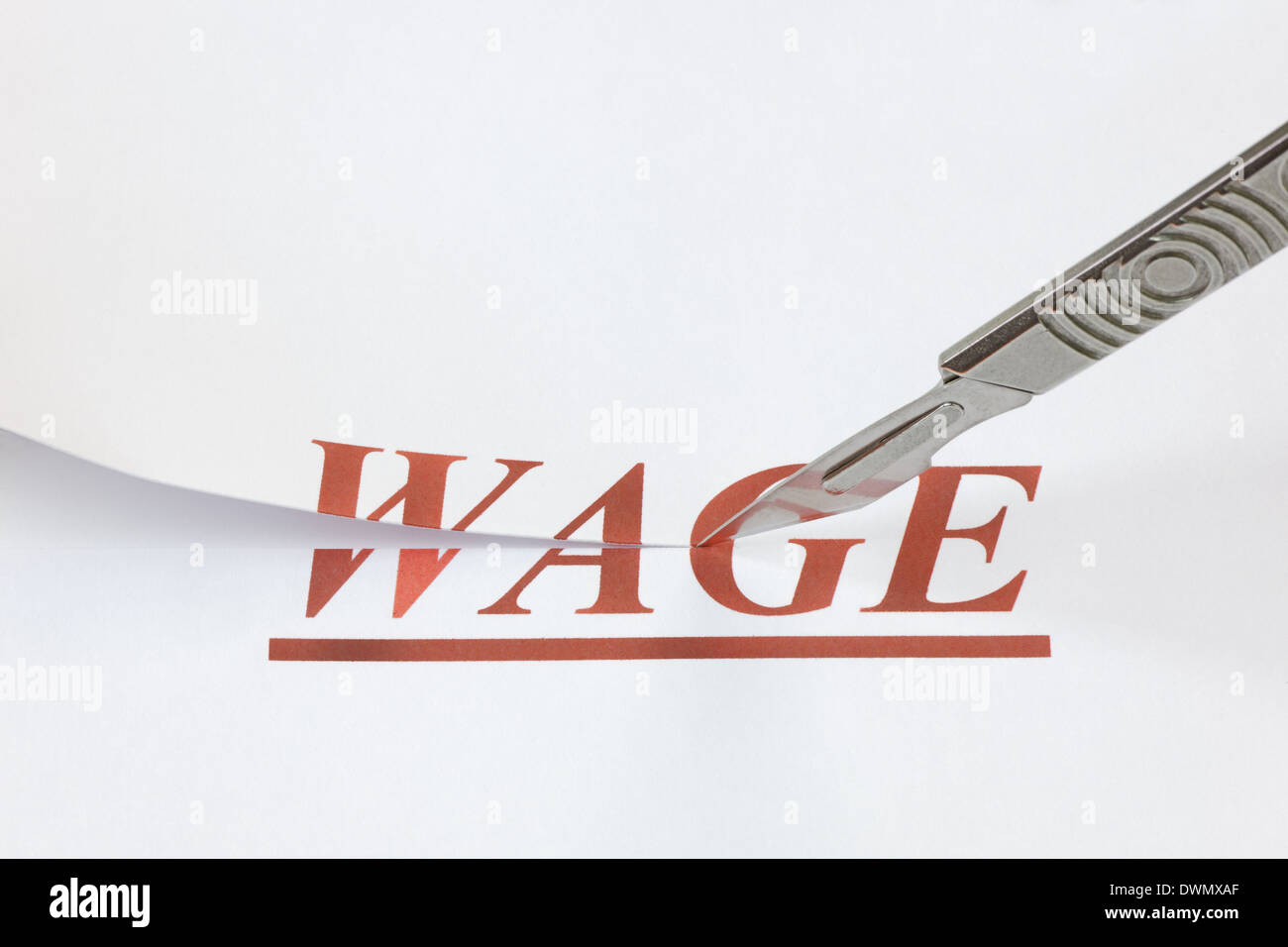 A scalpel cutting through the word Wage. Concept denoting a wage or salary cut, or reduced income because of a falling economy. - Stock Image