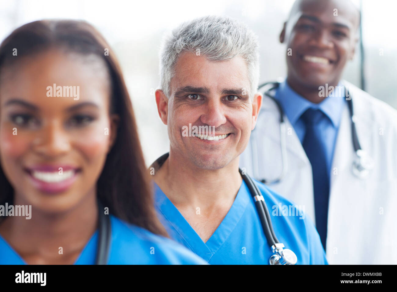 portrait of senior doctor and colleagues - Stock Image