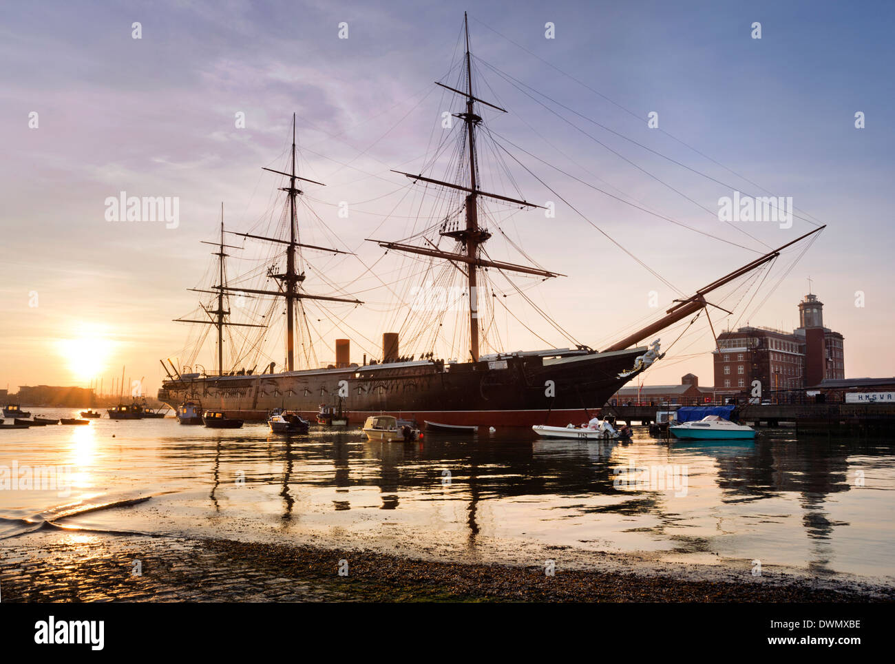 Historic warship HMS Warrior seen at sunset, moored in Portsmouth Harbour, Hampshire, UK - Stock Image