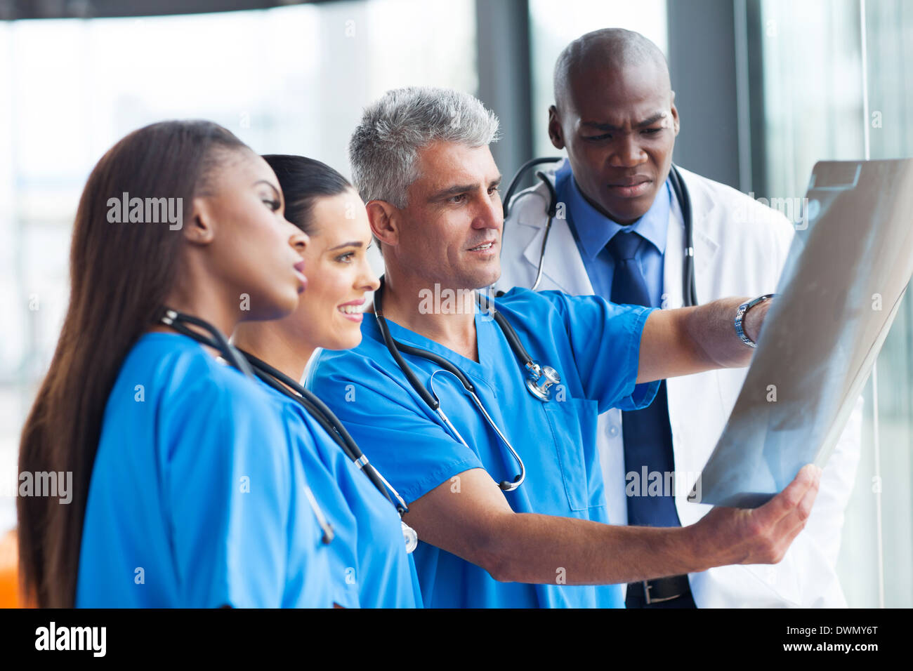 group of doctors looking at patient's x-ray - Stock Image