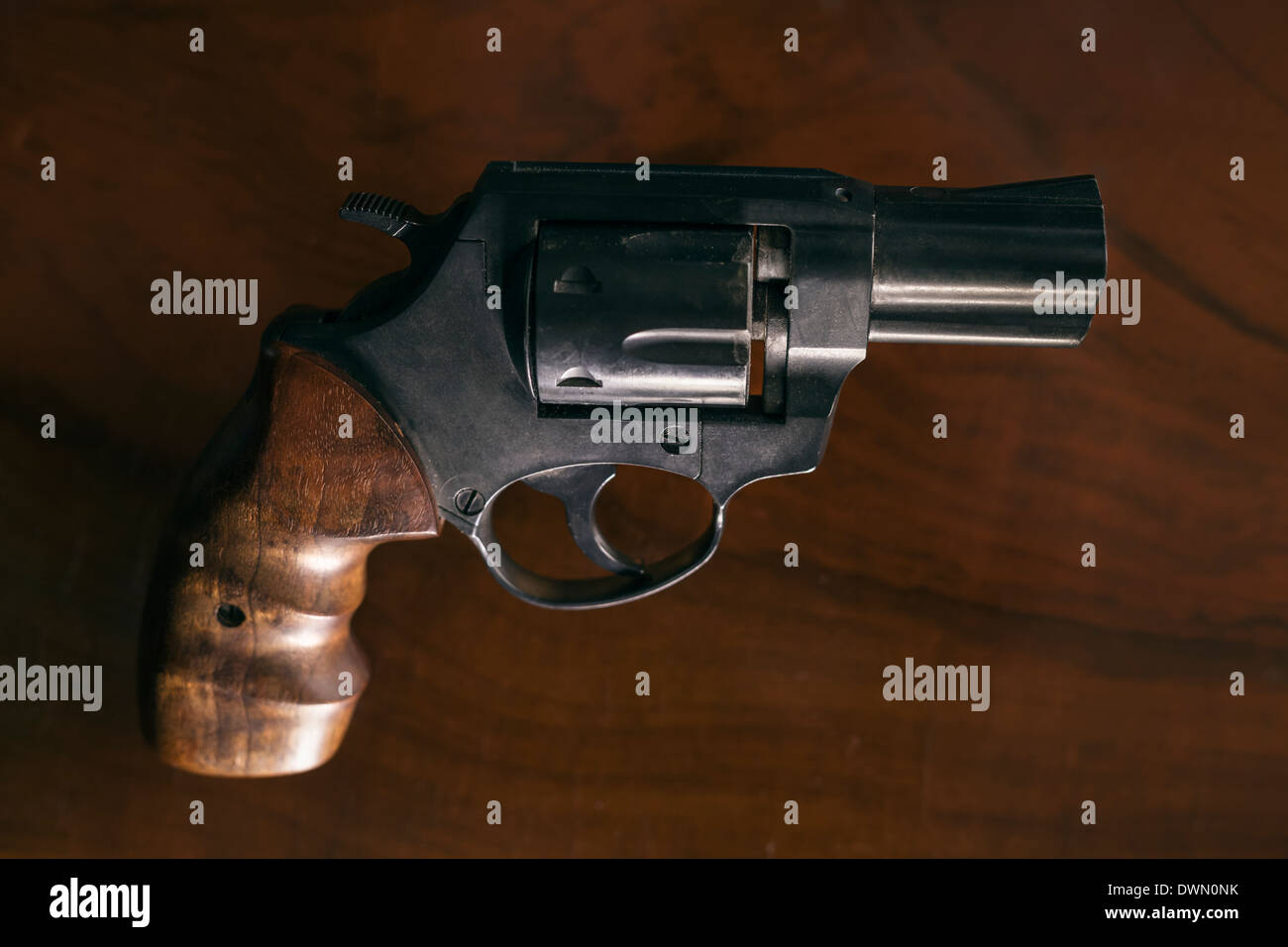 Revolver handgun over wooden background. - Stock Image