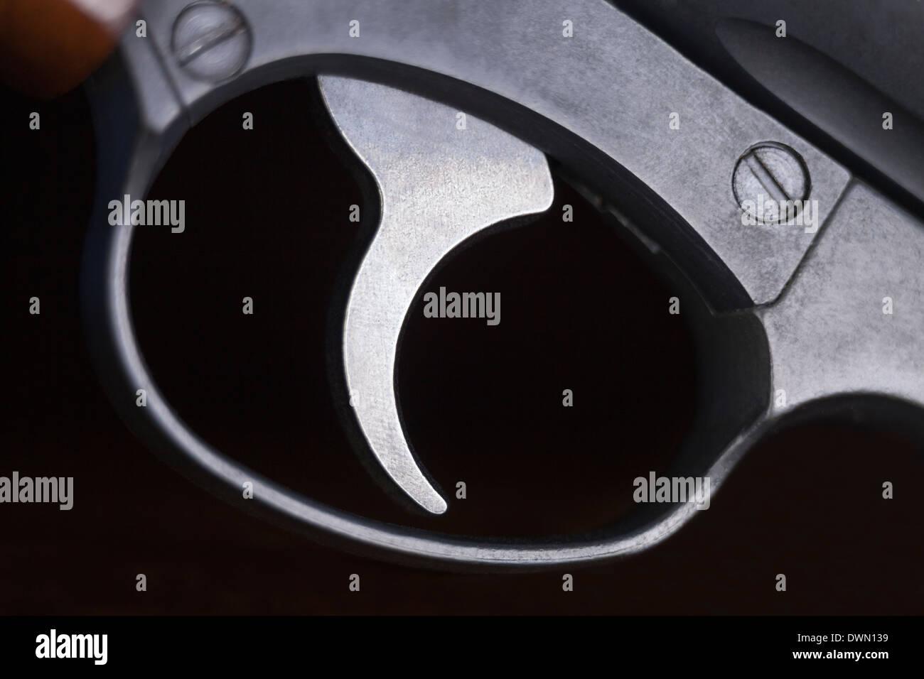 Macro of revolver gun trigger. - Stock Image
