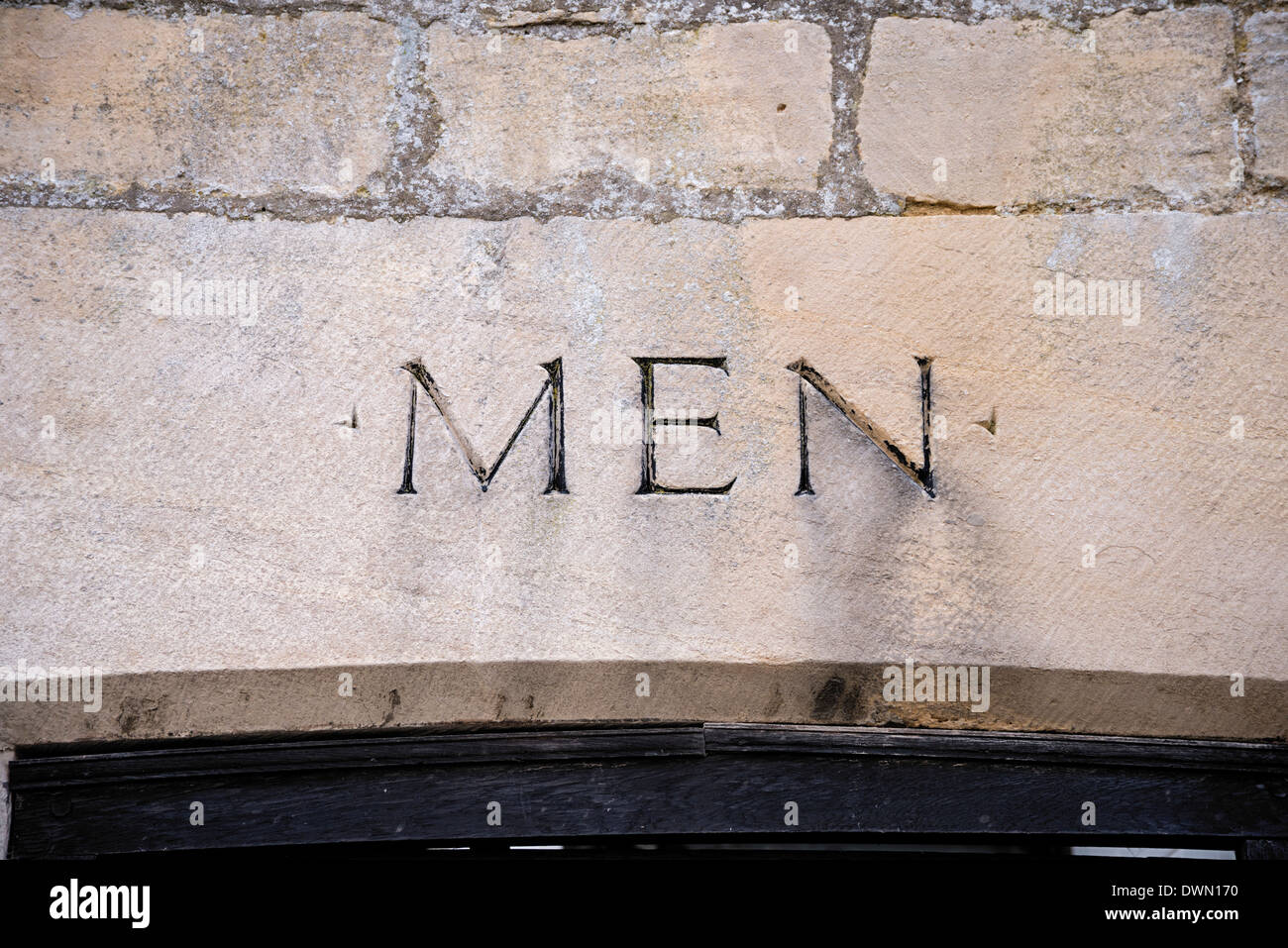 Mens toilets sign in Cotswold stone, Painswick, Glos - Stock Image