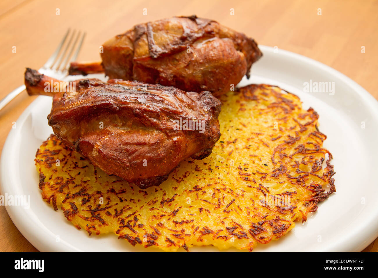 pig knuckle with potato fritter - Stock Image