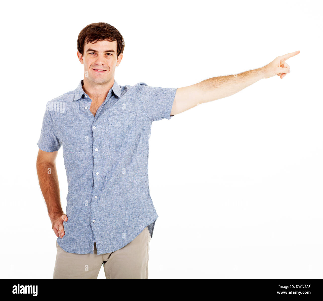young man pointing on white background - Stock Image