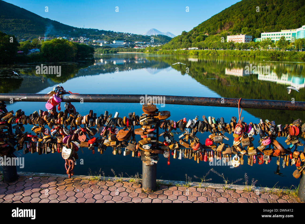 Lots of padlocks and chains on a handrail above an artifical lake in Petropavlovsk-Kamchatsky, Kamchatka, Russia, Eurasia - Stock Image