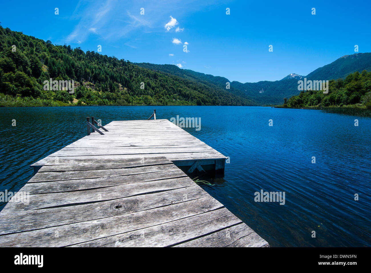 Wooden boat pier on Lago Tinquilco in the Huerquehue, southern Chile Stock Photo