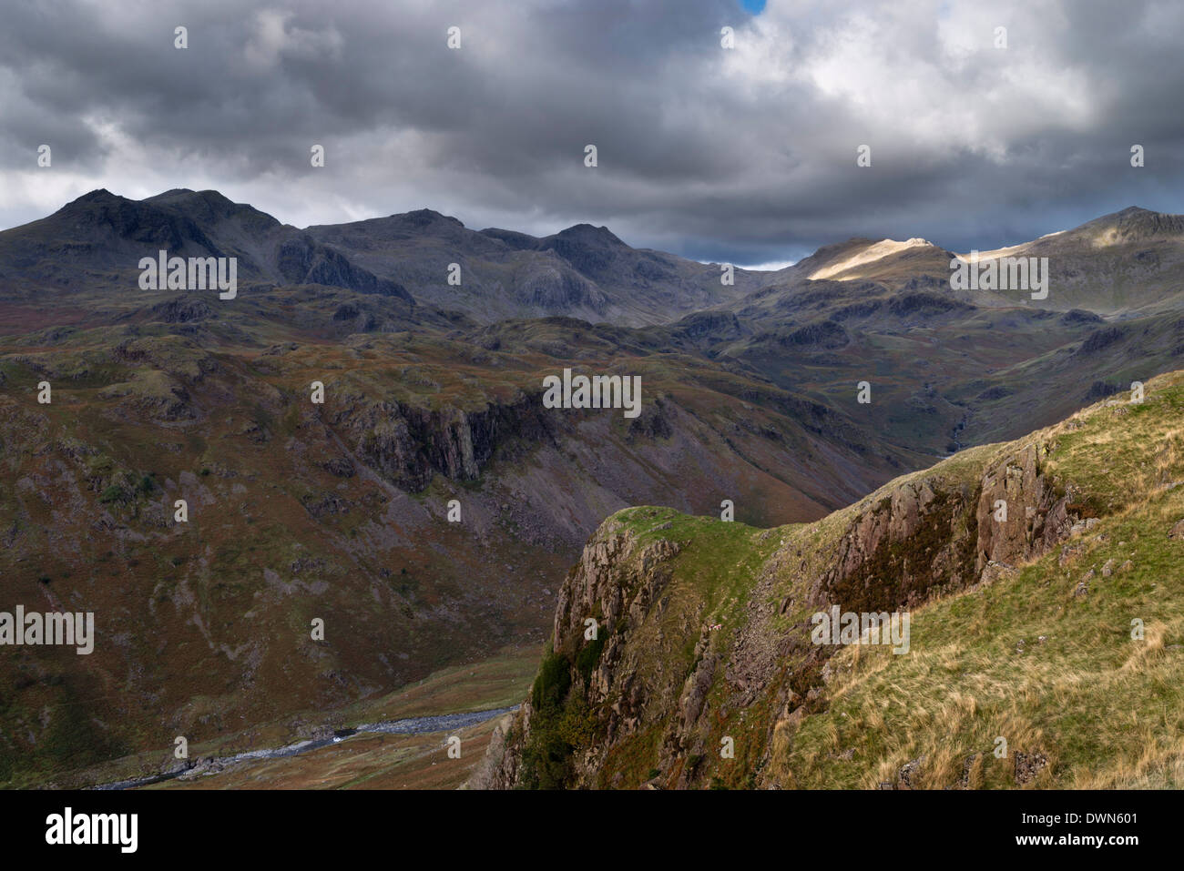 Dramatic light in this view from Yew Crags into Eskdale, Lake District National Park, Cumbria, England, United Kingdom, Europe - Stock Image