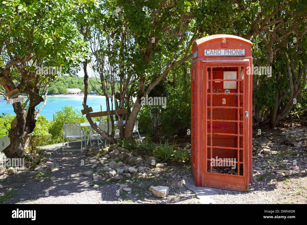 Red Telephone Box at Mama Pasta's, Long Bay, Antigua, Leeward Islands, West Indies, Caribbean, Central America - Stock Image