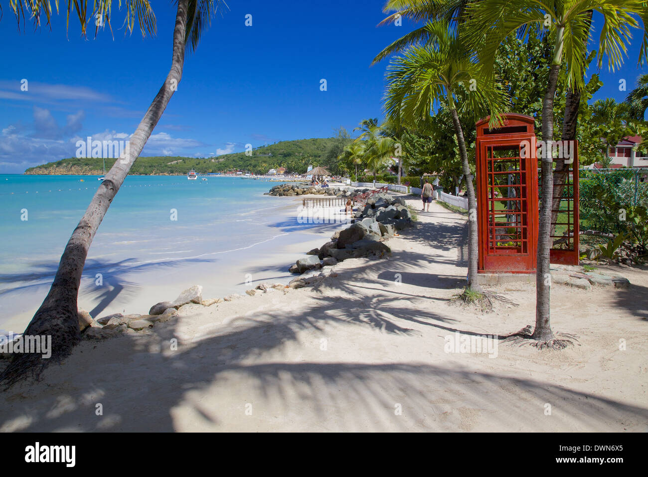 Beach and red telephone box, Dickenson Bay, St. Georges, Antigua, Leeward Islands, West Indies, Caribbean, Central America - Stock Image