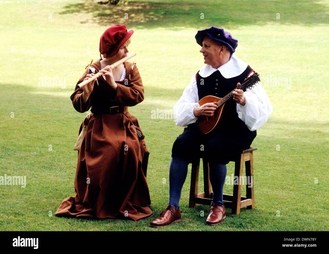 Stuart Period Musicians, early 17th Century, historical re-enactment music musical instrument instruments fashion fashions costume costumes musician England UK - Stock Image