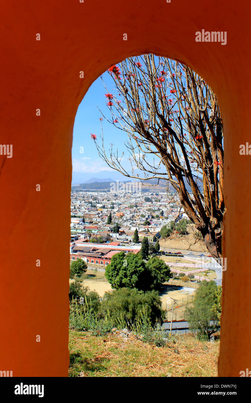 Looking down on Cholula through an archway on top of the Great Pyramid, Cholula, Puebla, Mexico - Stock Image