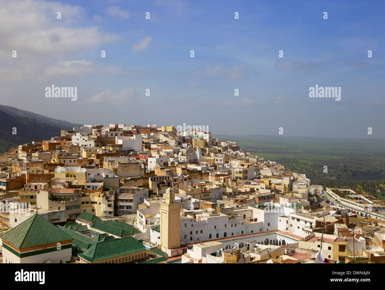 Aerial view of the tiled roofs of the sacred city of Moulay Idriss, including Zaouia of Moulay Idriss, Morocco, Africa - Stock Image