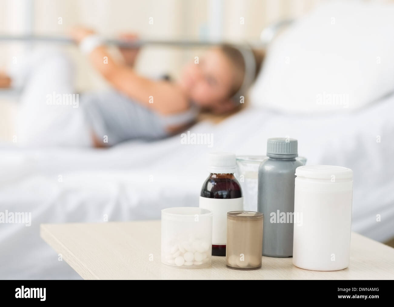 Medicines on table with girl in hospital - Stock Image