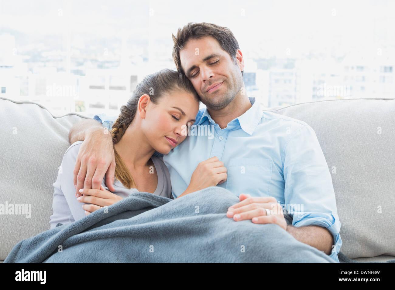 Interesting couple sleeping under blanket apologise
