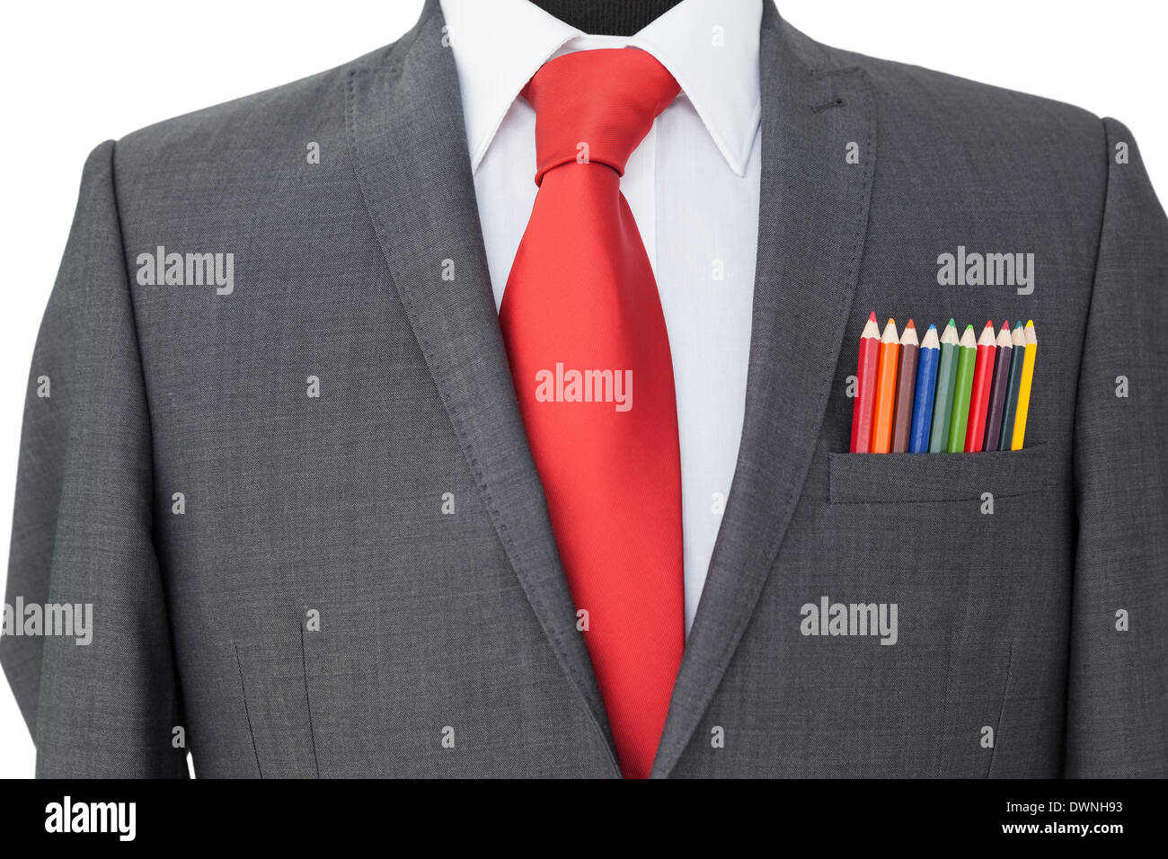 Close-up of colored pencils in coat pocket - Stock Image