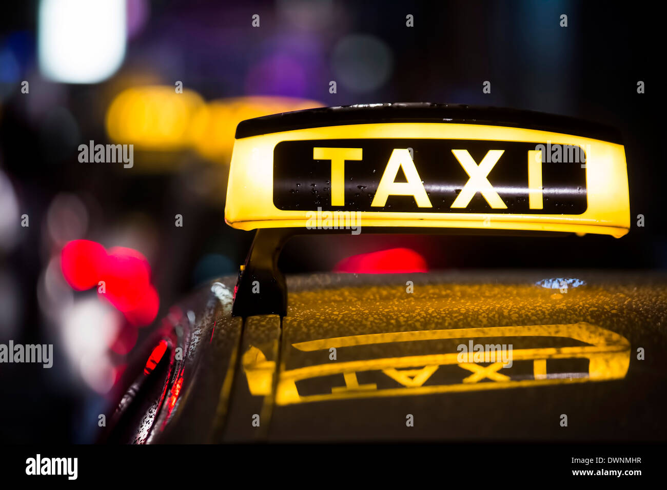 Taxi in the rain at night, Cologne, North Rhine-Westphalia, Germany - Stock Image
