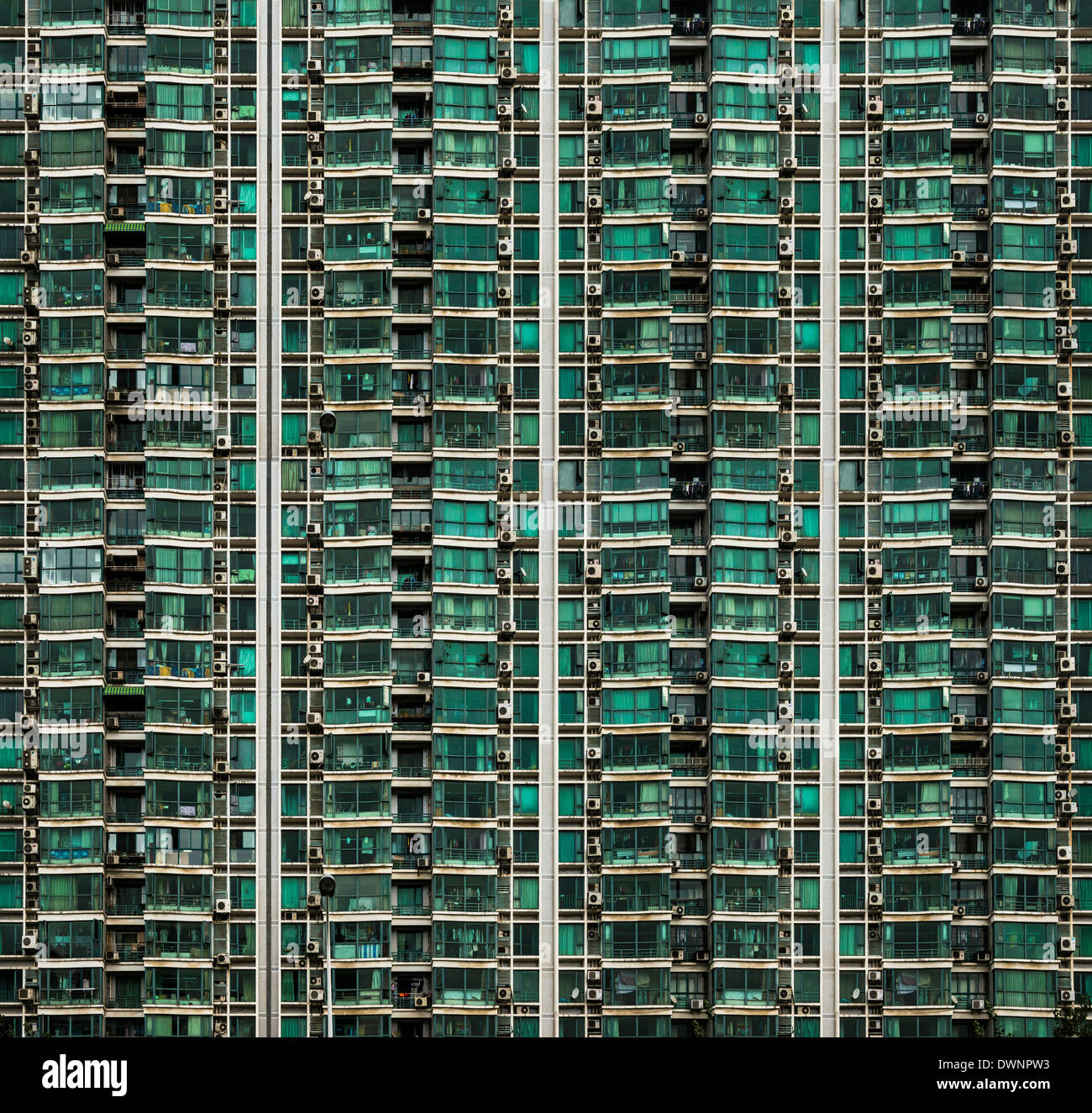 Façade of a high-rise building with balconies and air conditioning units, Shanghai, China - Stock Image