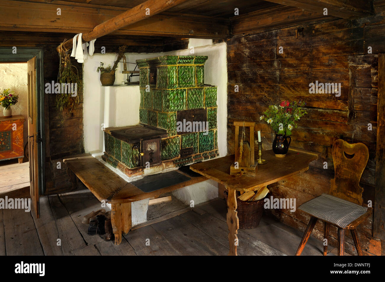 Living room with a tiled stove in Markus Wasmeier Farm and Winter Sports Museum, Schliersee, Upper Bavaria, Bavaria, Germany - Stock Image