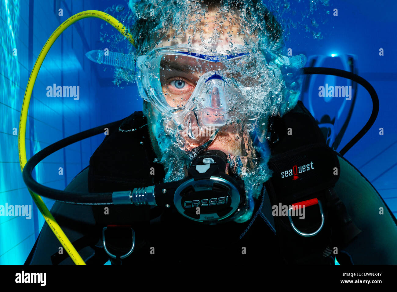 Scuba diver with air bubbles, portrait, in a swimming pool, Nuremberg, Bavaria, Germany - Stock Image