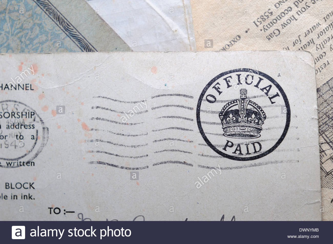 Official Paid stamp on a postcard from Jersey immediately after WWII. - Stock Image